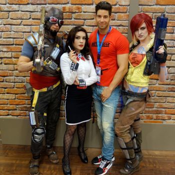 Lucas Liaskos surrounded by cosplay heroes